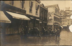 Group of People In Flooded Street with Boat