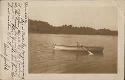 Young Boy in Rowboat on Lake
