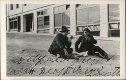 """Scotty"" and the Chinaman - Two ""refugees"" sitting in the streets of Ravol"