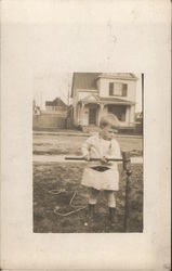 Small Child Playing with Croquet Mallet