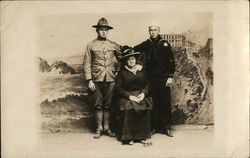 A Soldier and a Sailor Posing with an Older Woman