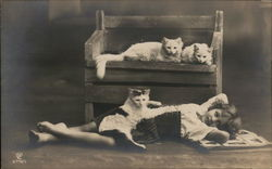 Young Girl Reclining on Floor with Three Cats