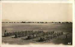 Four Lines of Soldiers Marching on Field