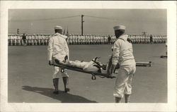 Two Sailors Carrying a Sailor on a Stretcher