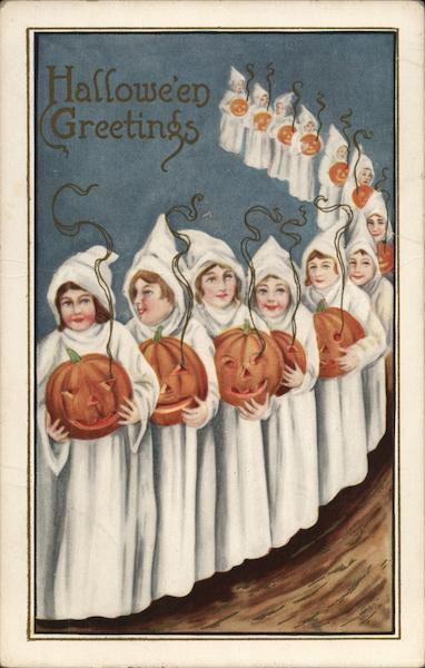 Line of White-Robed People Holding Jack-o-Lanterns
