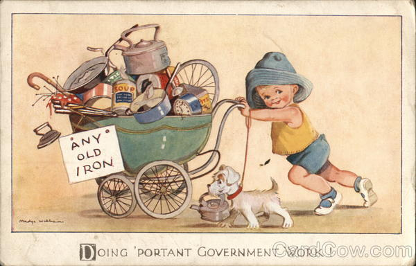 Little Boy Pushing Full Carriage with Sign: Any Old Iron