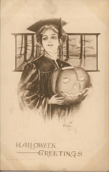 Woman in Cap and Gown Holding Jack-o-Lantern Kathryn Elliott