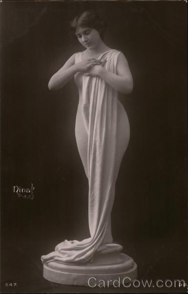 Nina: Woman on Pedestal with Flowing Fabric Draped to Floor