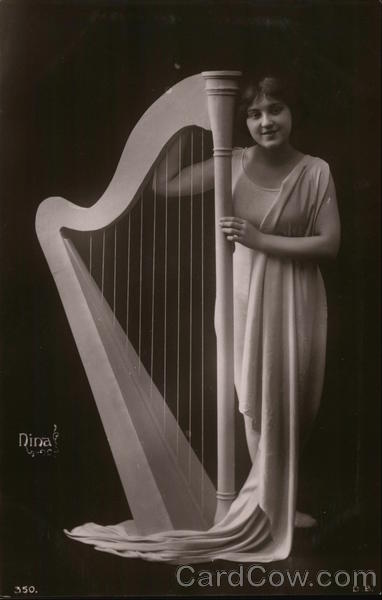 Woman in Flowing Garment Standing Next to Harpsichord