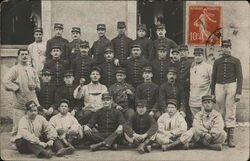 Uniformed Men Posing for Four-Tier Group Photo
