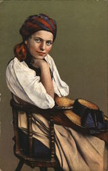 Woman Wearing Bandana Seated in Wooden Chair, Hat in Lap