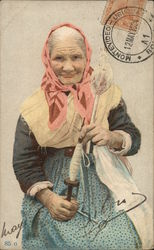 Older Woman in Pink Scarf Holding Large Spool and Tool