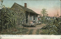 House Situated Among Cornfields with People on Porch