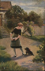 Woman With Dog at Her Feet Outdoors