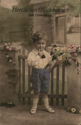 Young Boy Holding Bouquet of Flowers