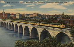Streamliner Crossing Mississippi River Over Stone Arch Bridge, Minneapolis, Minn.