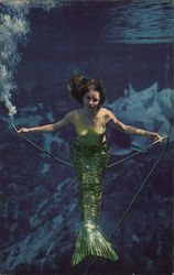Woman Dressed as Mermaid Under Water