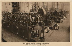 Interior view of shop at Dunlop rim and wheel works Postcard