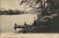 Three People with Small Boat at Water's Edge