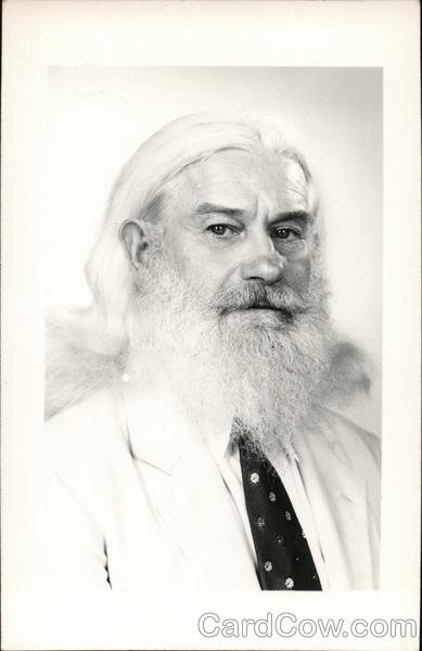 A Man With Long White Hair and a White Beard Men