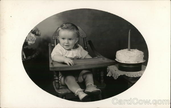 Blond Toddler in High Chair Near Cake with One Candle Benton Harbor Michigan