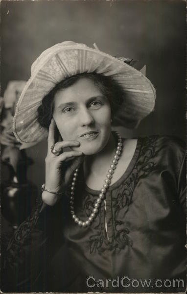 A Woman Wearing a Hat and Pearls House of David