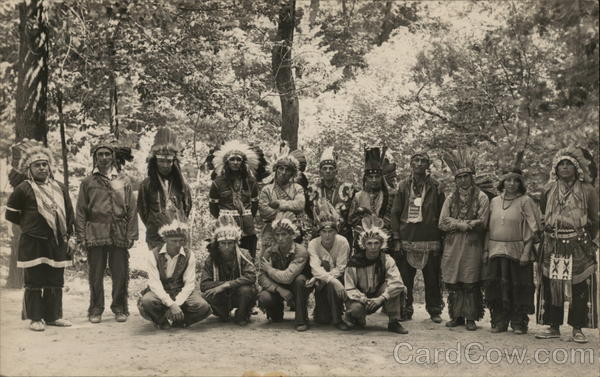 A Group of People Wearing Indian Headdresses House of David