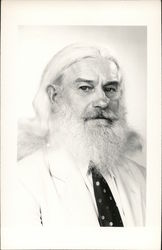 A Man With Long White Hair and a White Beard