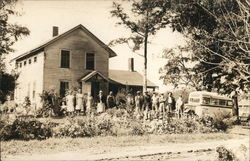 Group in a Line Standing in Front of House