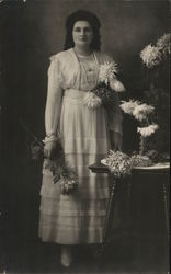 Mary Purnell Holding Flowers