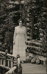 Mary Purnell Standing on a Bridge