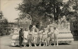 Six Women, Two Men Standing on Front of Parade Float, 1930