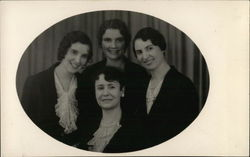 Four Women Smiling, Pictured in an Oval View