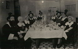 Men and Women Dressed as Pilgrims Around Table