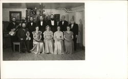 Group of Men and Women in Evening Apparel Posing for Photo