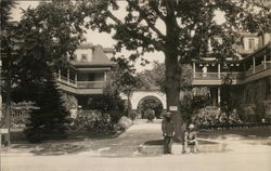"Wide View of Trees, Buildings, ""House of David"" Archway"" & Two Men"