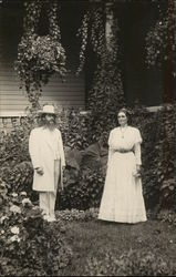 Benjamin and Mary Purnell Standing Outdoors Near Foliage