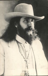 A Man in a White Suit and White Cowboy Hat