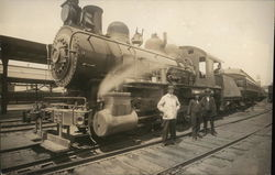 Train on Tracks, Three Men Standing Next to Locomotive