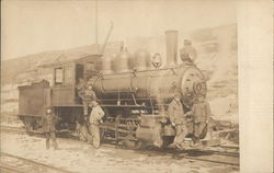 Train Engine and Workers on Tracks