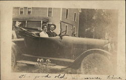 Man and Woman in Automobile with Top Down