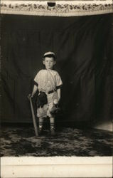 Boy Posing in Baseball Uniform