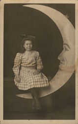 Studio Portrait of Girl on a Paper Moon