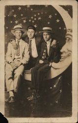Three Men Seated in Paper Moon