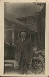 Dr. Cook - Standing Near Automobile Holding Small Case