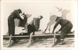 Workers on Roof Setting up Reindeer Decorations
