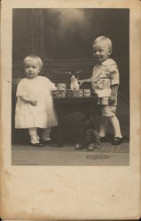 Portrait of Two Children With Toys
