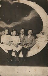 Three Children, One Adult Posed on Crescent Moon