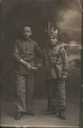 Two Boys in Costumes Shaking Hands