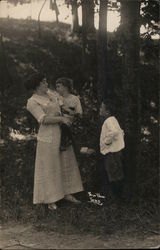 Woman With Two Children Near Trees